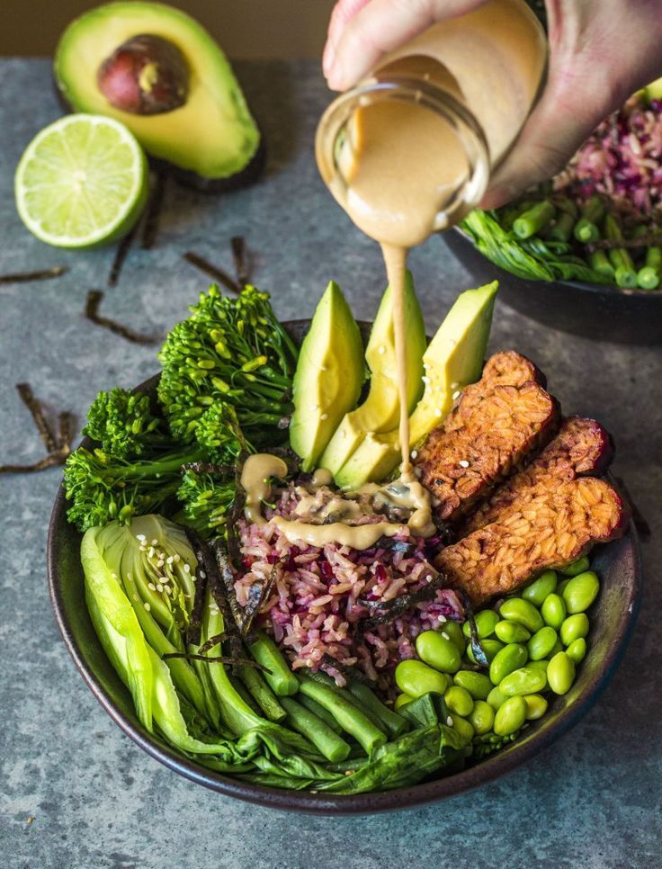 Photo of Healthy Asian Greens Bowl with marinated tempeh, drizzled with tahini! I'm testing o …