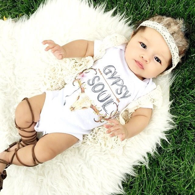 My little wild child. ✌️ 06.28.15 || 3 months  Feather crown : @littlegoldleaf  Gypsy Onesie : @thepinetorch Crochet vest : @thewildthreads Gladiator sandals : @bravelittlesole