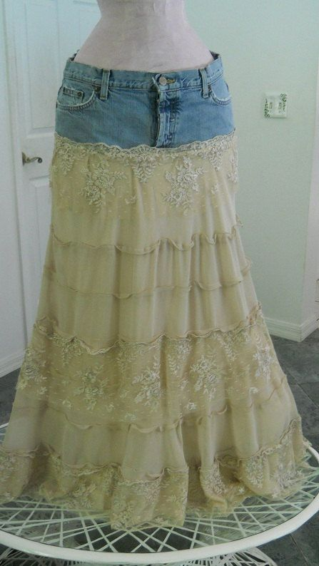 """To make the """"""""Isabelle"""" jean skirt,  took a pair of faded, destroyed jeans with cool tatters, rips and holes to form a yoke for the top.Next, made a skirt bottom out of tiers of beige ecru silky crepe and lined it with a satiny beige lining.Then, I made tiers of exquisite vintage lace and tattered the lace to complement the destroyed denim."""