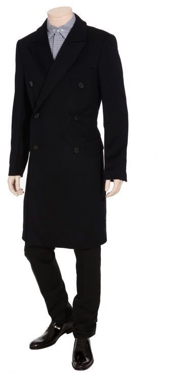 Stay stylish and warm this season with this double breasted wool coat from  Yves Saint Laurent, a fine full length outerwear choice for the .