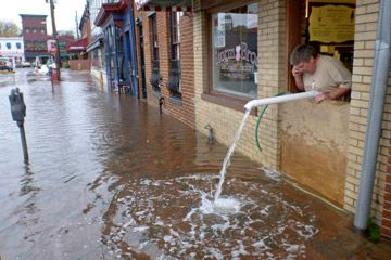 Sveinn Storm pumping water out of his flooded store, Storm Bros. Ice Cream Factory, in October 2012 in Annapolis, Md.