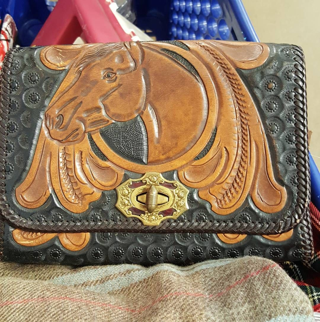 Look what jumped into my cart this morning. LOVE.  #thriftstorefinds #goodwillfinds #tooledleatherbag #vintagehandbag #horses#vintageebay