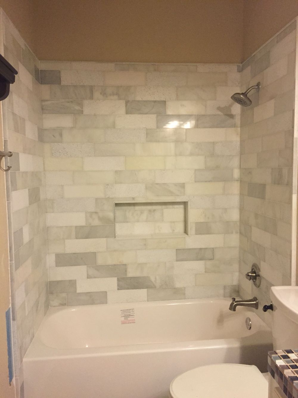 Mixed marble and textured white subway tile tub surround tile job mixed marble and textured white subway tile tub surround tile job doublecrazyfo Images