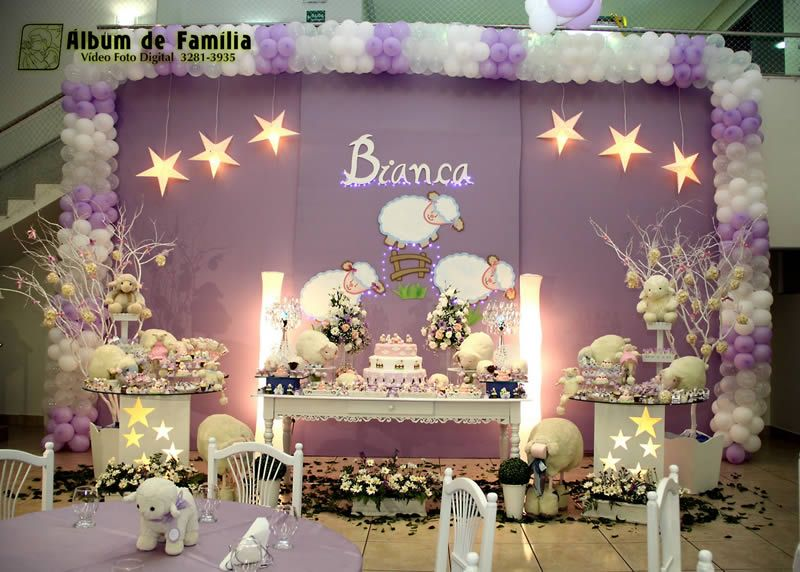 Purple party theme theme birthday party sheep birthday for Baby birthday decoration photos