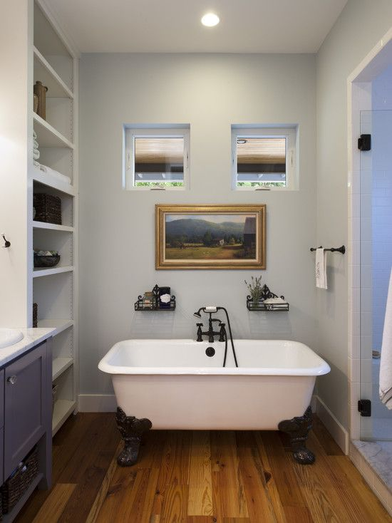 Modern Ensuite Bathroom Design and Idea: Endearing Farmhouse Ensuite Bathrooms Also White Classic Bathtub With Brown Elegant Legs Also Classic Shower Head Also Light Grey Wall Paint Color Also Small Ceiling Light And Classic Towel Rail And Mod Shelves ~ kitchentablecomics.com Bathroom Ideas Inspiration