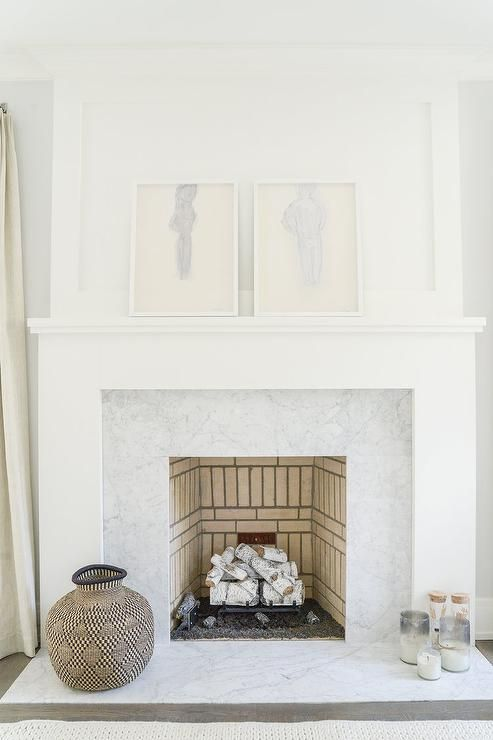 Two white framed abstract nude sketches sit side-by-side on a white ...
