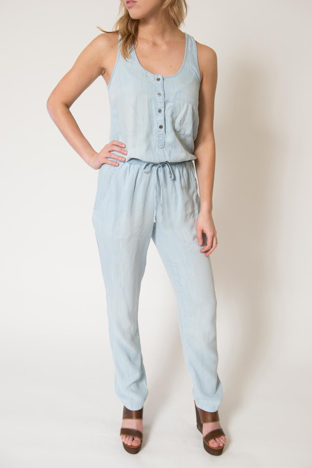 fbc499750883 A fun woven denim jumpsuit that is just lightweight enough to pair with a  kimono or even worn alone for a beach vacation! Woven Denim Jumpsuit by RD  Style.