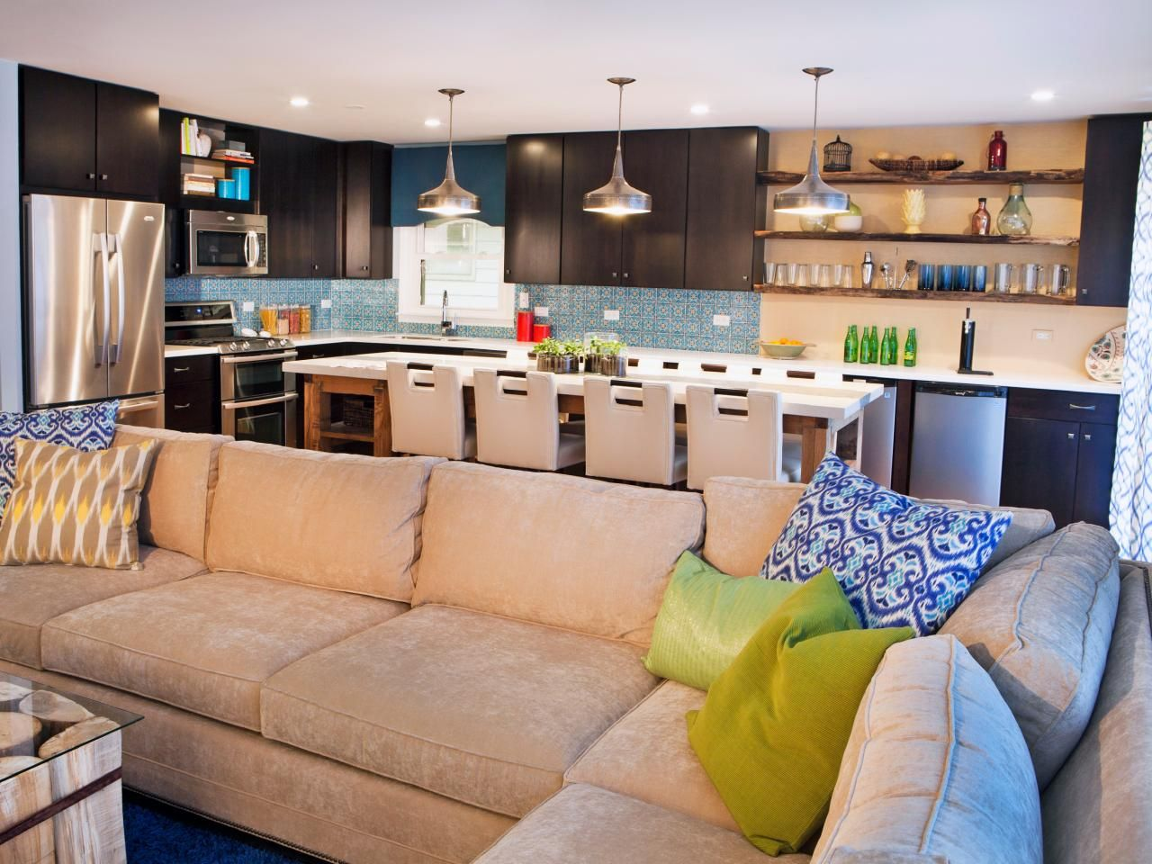 Contemporary Open Living Space With Tan Sectional Sofa Open Kitchen And Living Room Contemporary Kitchen Open Concept Living Room #open #concept #living #room #with #sectional