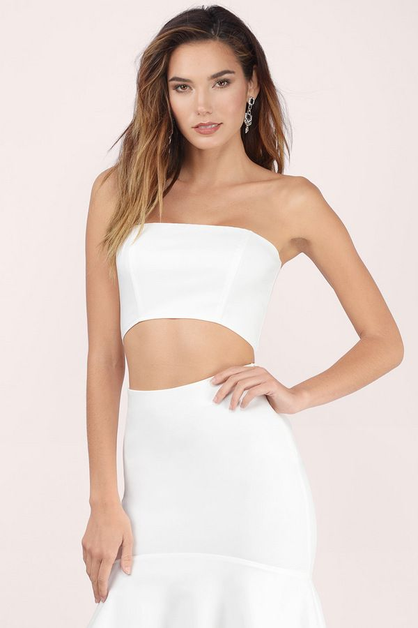 Designed by Tobi. The Anything Goes Strapless Crop Top fits to flatter with a curved front bottom and zip up back.
