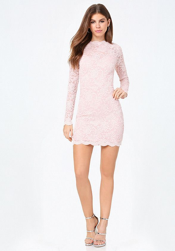 Amazing lace. Gorgeous lace dress finished with a chic boatneck and scalloped edges. Curve-flattering fit. Long sleeves. Hidden back hook-and-eye and zip closure. Partially lined.
