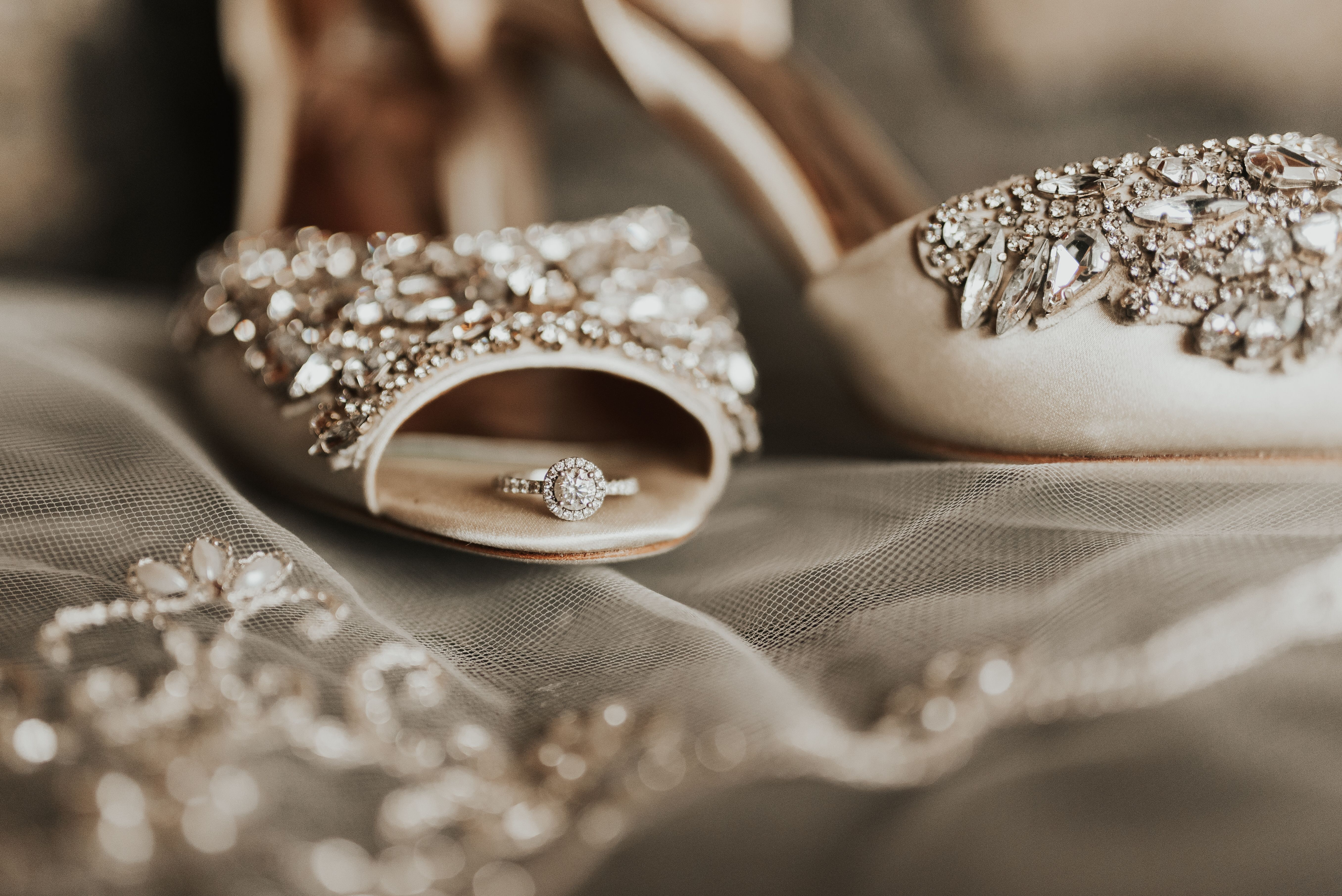 Wedding Photography Detail Shot With Shoes And Ring And Veil