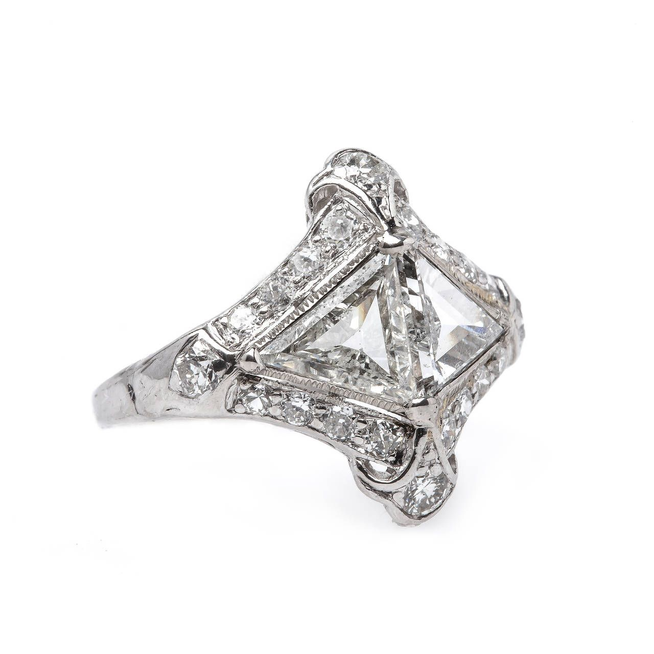 Unique Art Deco Platinum Engagement Ring with Triangular Cut Diamonds   From a unique collection of vintage engagement rings at https://www.1stdibs.com/jewelry/rings/engagement-rings/