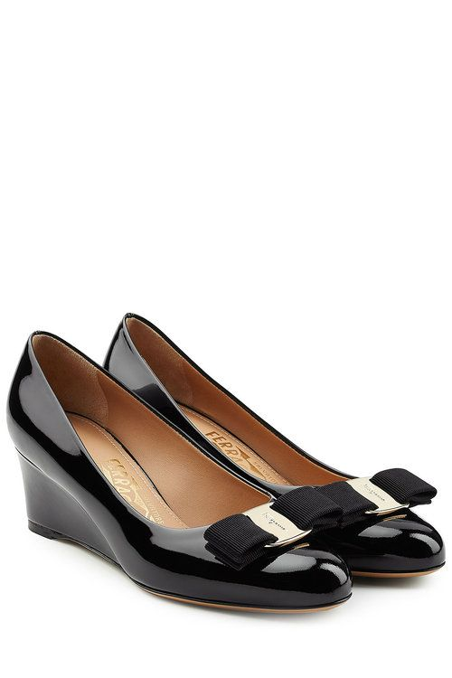a96db0d2e8df A small wedge makes these black patent leather pumps a flattering choice  from Salvatore Ferragamo.