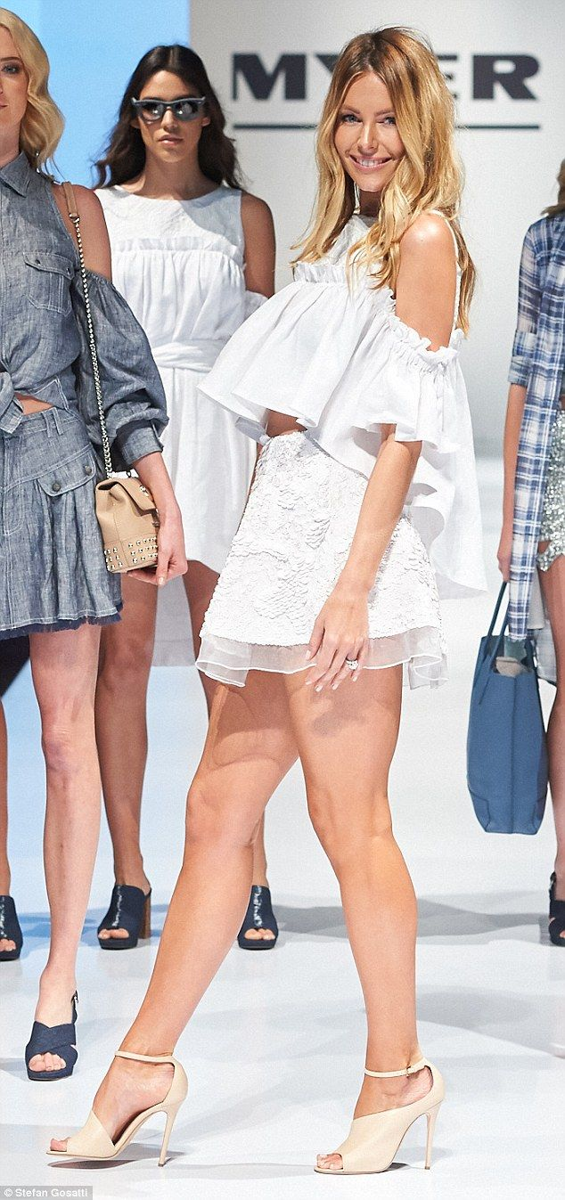 White hot: The brand ambassador flaunted her long and toned legs in a flirty white two-piece