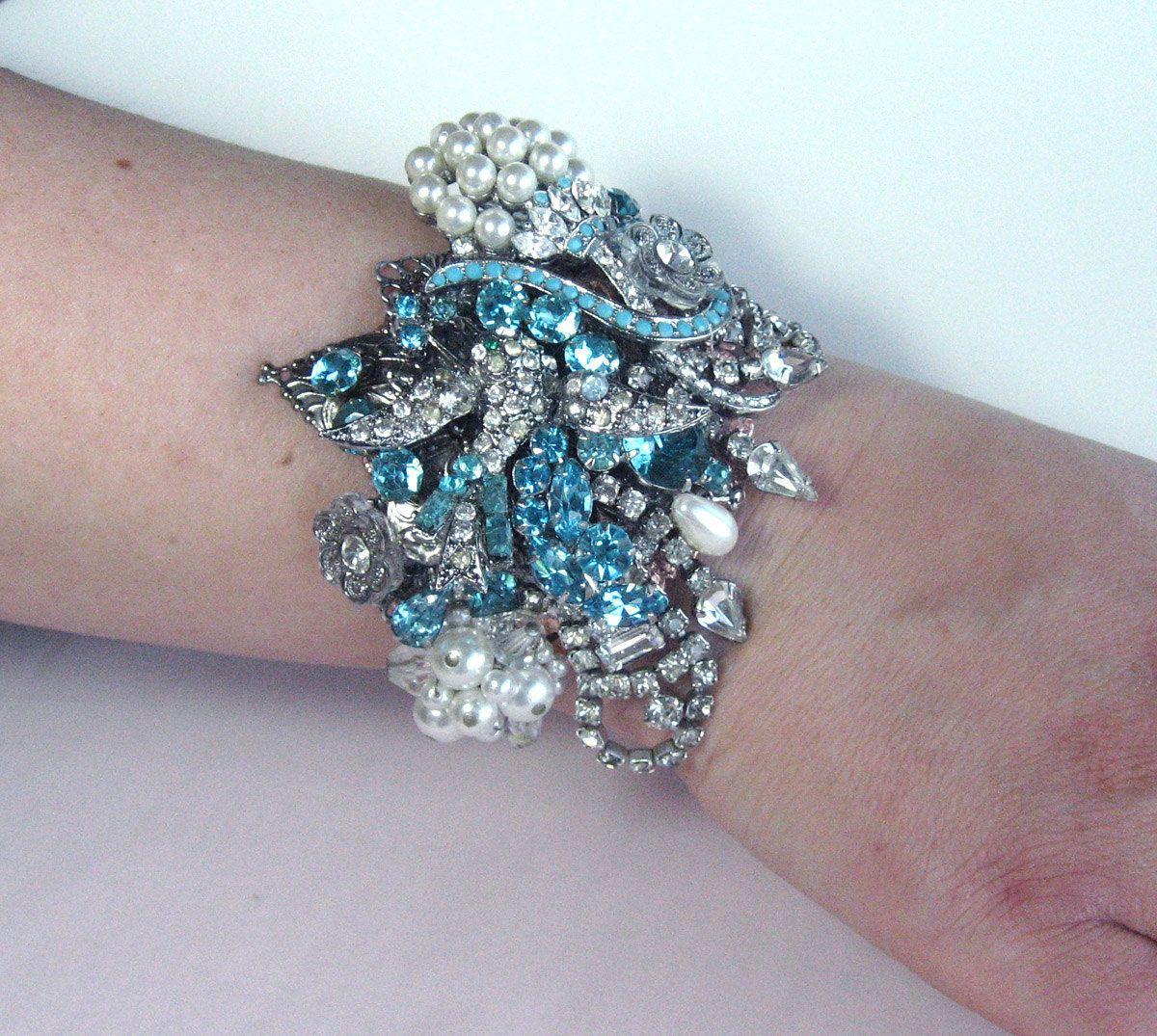 Gorgeous Aquamarine Blue Rhinestone Wedding Bracelet Cuff From Vintage Jewels. $175.00, via Etsy.