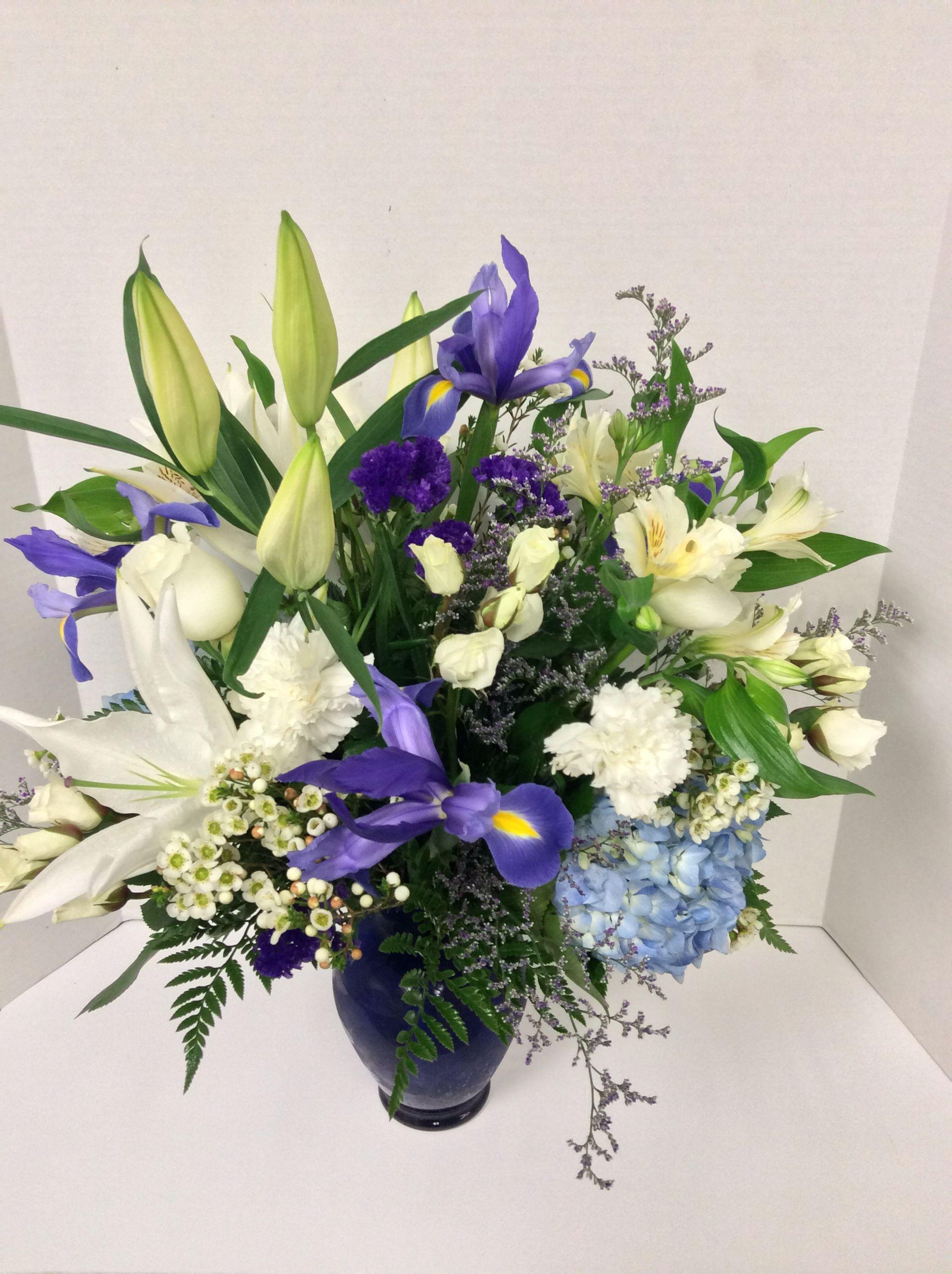 Fresh Vase Arrangement With White Stargazer Lilies Purple Iris