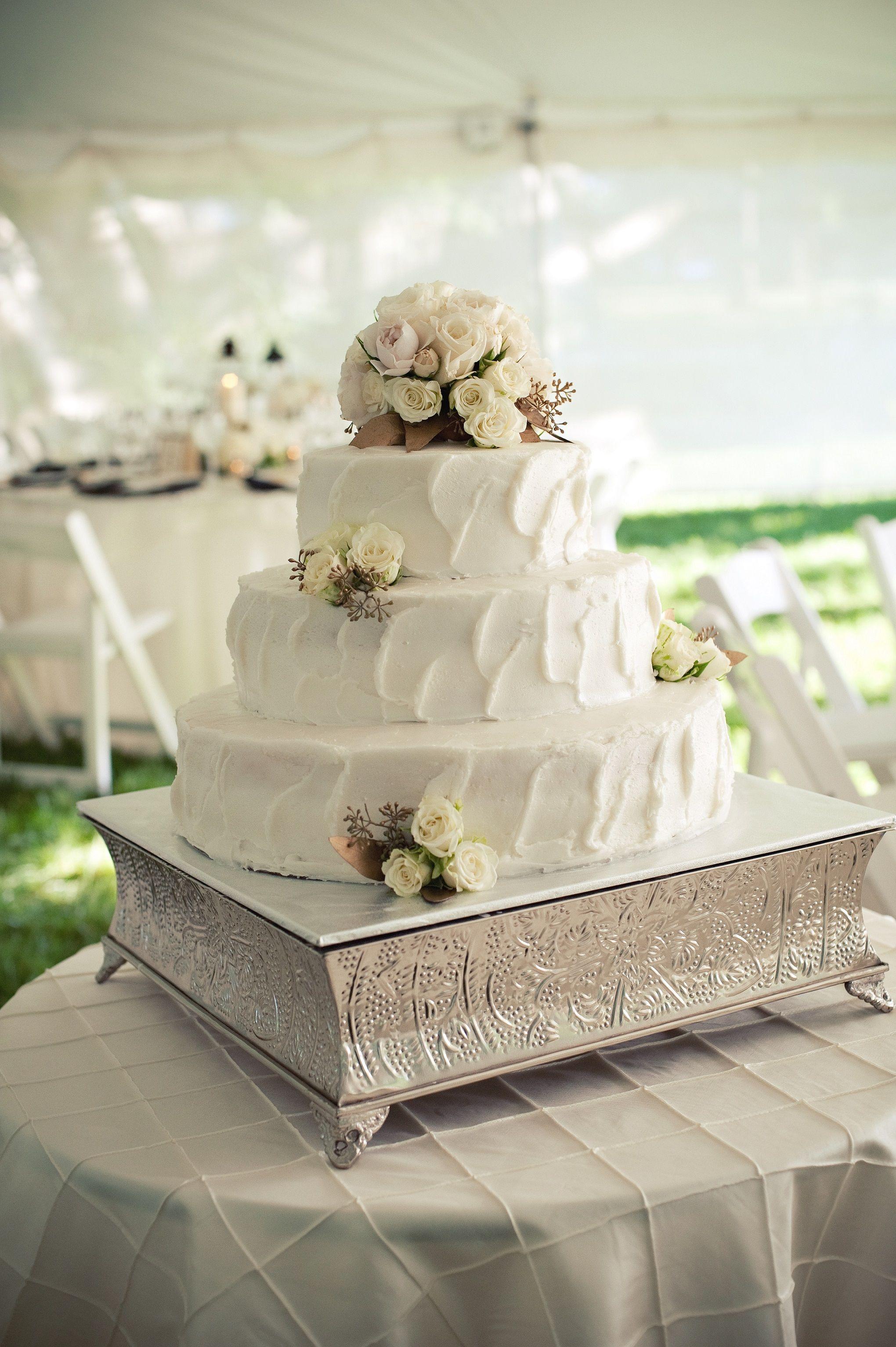ivory wedding cake buttercream frosting floral cake topper