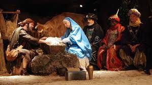Nativity Scene Depicting Joseph Mary Tenderly Looking At Baby Jesus In The Humble Manger With The Three Wise Men In The Backgroun Nativity Three Wise Men Atheist