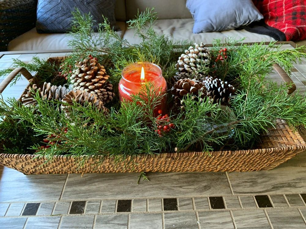 These cedar branches, red berries, and pinecones make for an easy Christmas centerpiece. For more elegant and simple holiday home decor ideas and inspiration head on over the Trendy Tree.