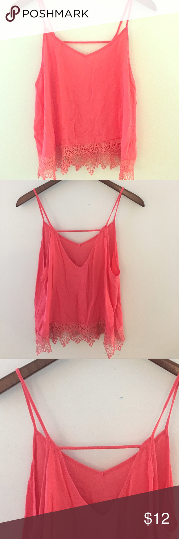 Boho Chic  Coral Top with lace accent Boho Chic  Coral Tank Top with lace accent in bottom edge. Interesting back. Tops Tank Tops