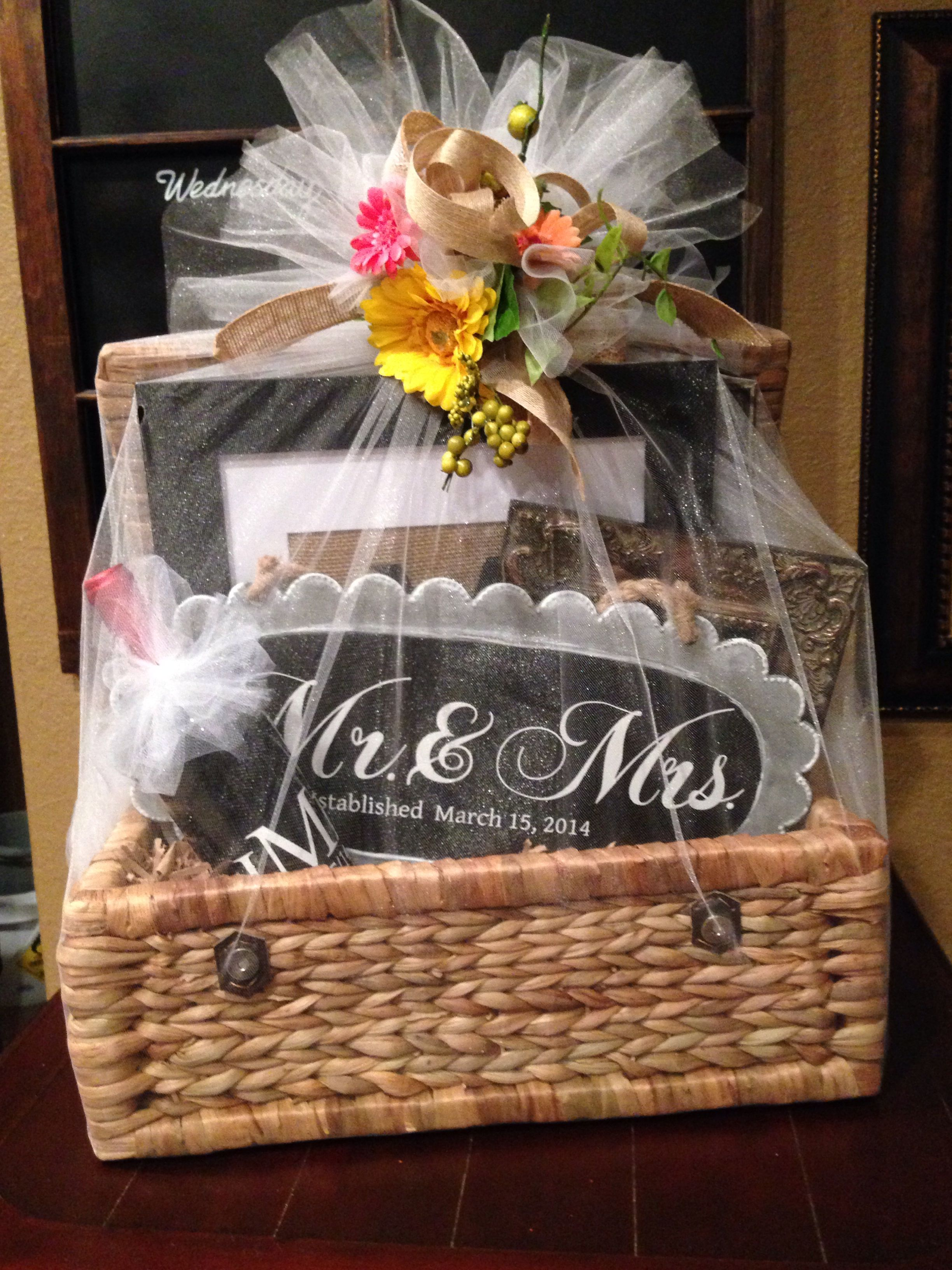 Wedding gift basket filed with personalized gifts made with my silhouette.  Wrapped with tulle and burlap flower ribbon. I love a pretty present! 49a36b064791
