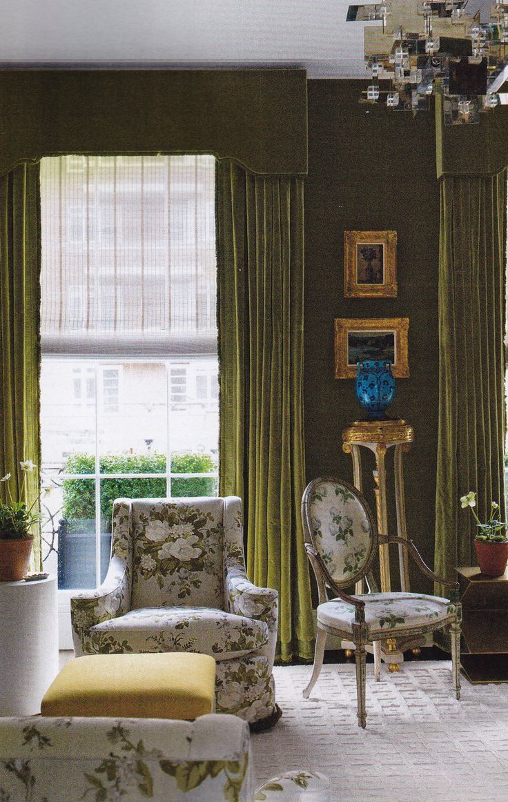 Mossy green velvet lines the walls and the windows of veere
