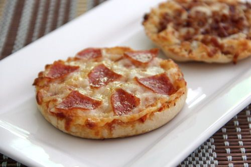 English muffin pizzas: SPREAD each muffin half with 1