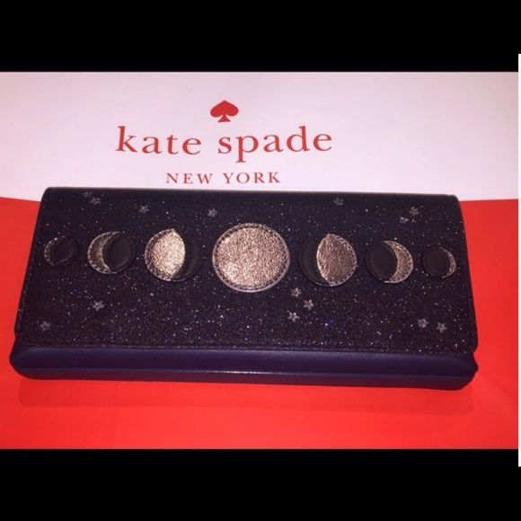 """Kate Spade Moon Clutch Beautiful Kate Spade Lido Avenue Moon Clutch!  Dark blue with a glitter finish flap adorned with different moon phases and stars.  Magnetic snap tabs hold the flap closed. Interior is lined with Blue Kate Spade fabric and has a multi function slip pocket on one side.  10"""" x 4.5"""" x 1.25""""  Comes with Kate Spade care card and gift bag.  No Trades. NWOT kate spade Bags Clutches & Wristlets"""