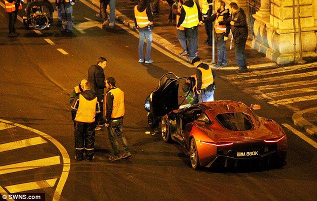 Driving force: Two vehicles - including Bond's Aston Martin - brought the Italian city of Rome to a standstill on Friday morning as filming continued to gather pace on Spectre