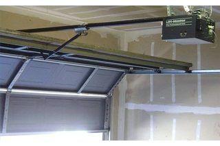How To Fix A Loud Squeaky Garage Door Ehow Garage Door Maintenance Garage Doors Garage Door Springs