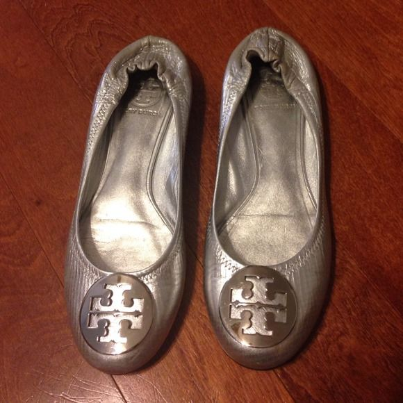 Tory Burch Reva flats Silver authentic metallic leather Reva flats size 7.5. Too small for me. Lightly used Tory Burch Shoes Flats & Loafers