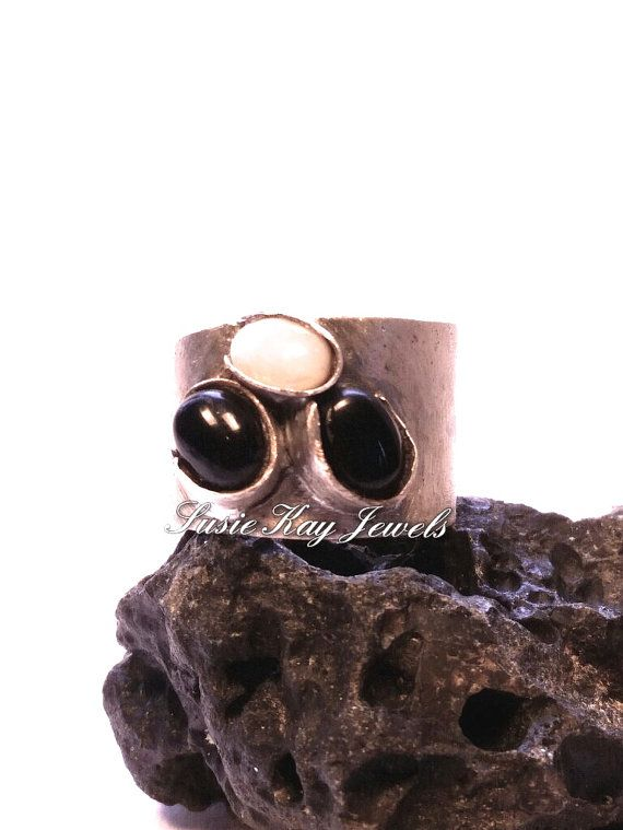 Check out this item in my Etsy shop https://www.etsy.com/listing/228064833/black-onyx-and-opal-ring
