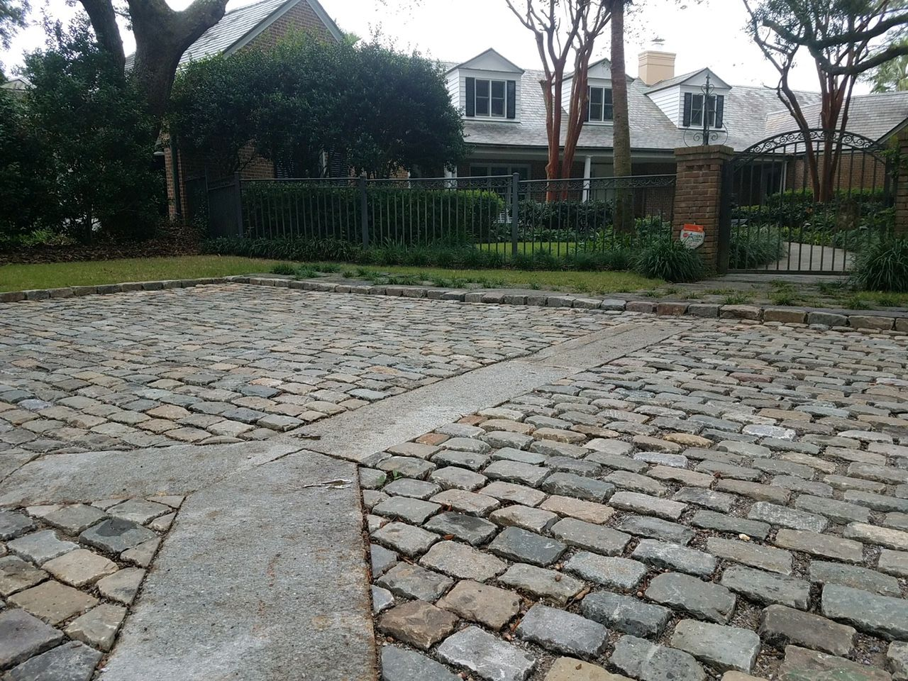 Reclaimed Cobblestones Are A Highlight In This Driveway