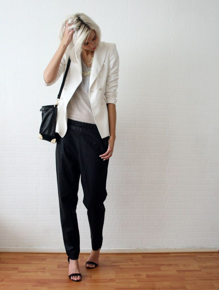 White blazer and black baggy leather pants. Relaxed chic
