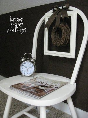 I found old chairs at an antique's store...not great for sitting, but perfect for holding magazines in a bathroom corner! Here's a similar idea.