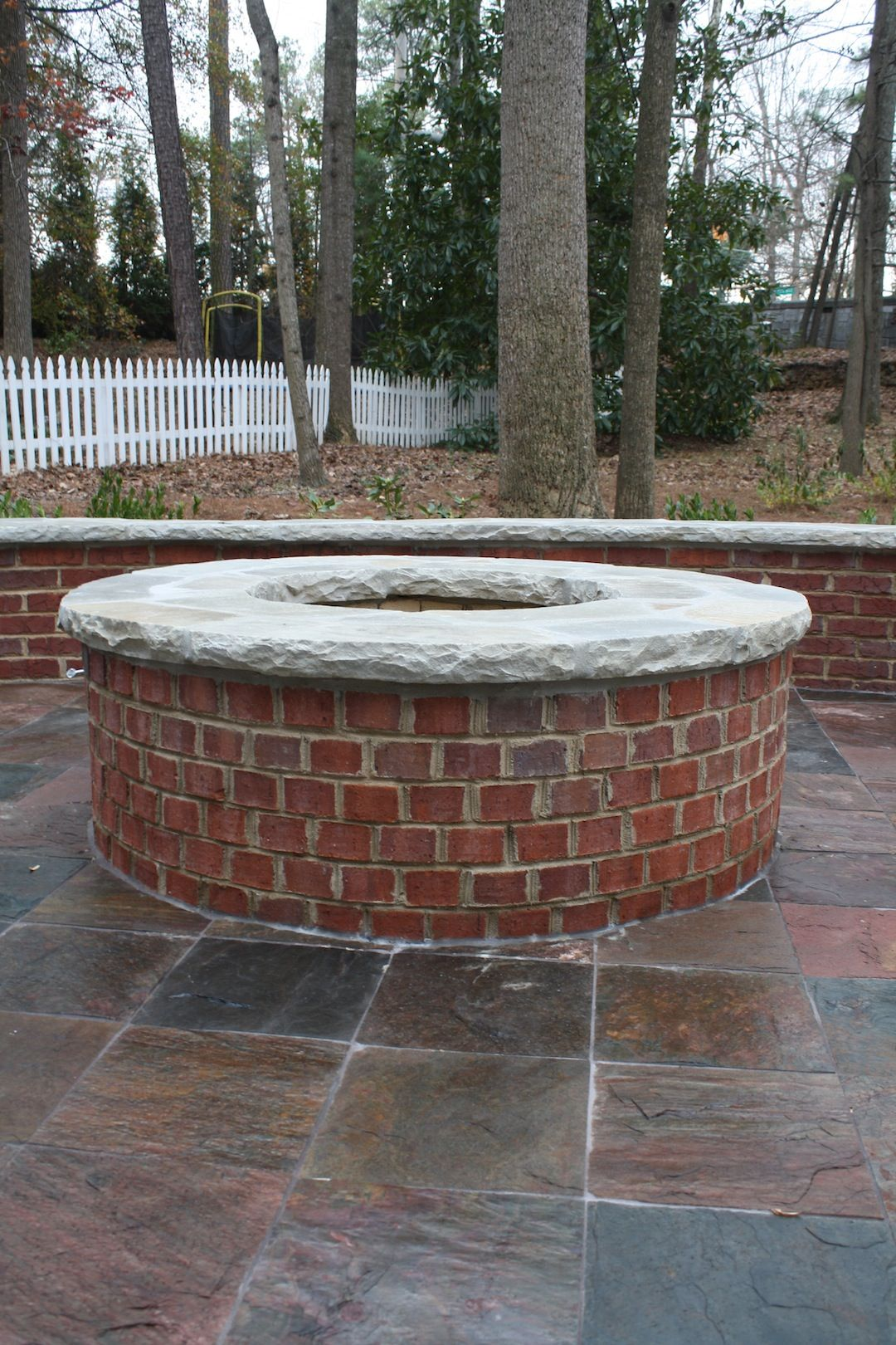 Red brick firepit with stone cap fireplaces and firepits for Backyard brick fire pit