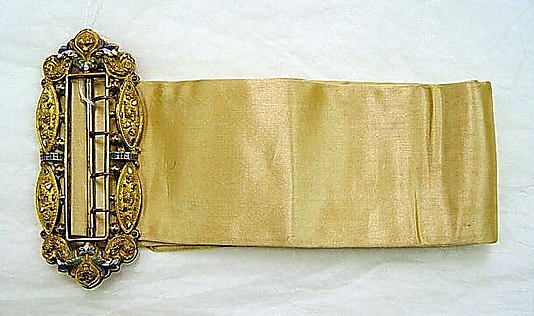 Belt Date: 1830s Culture: American or European Medium: (a) silk; (b) metal, enamel Dimensions: Total Length: 4 in. (10.2 cm) Total Length: 27 1/2 in. (69.9 cm) Credit Line: Isabel Shults Fund, 2002 Accession Number: 2002.408a, b