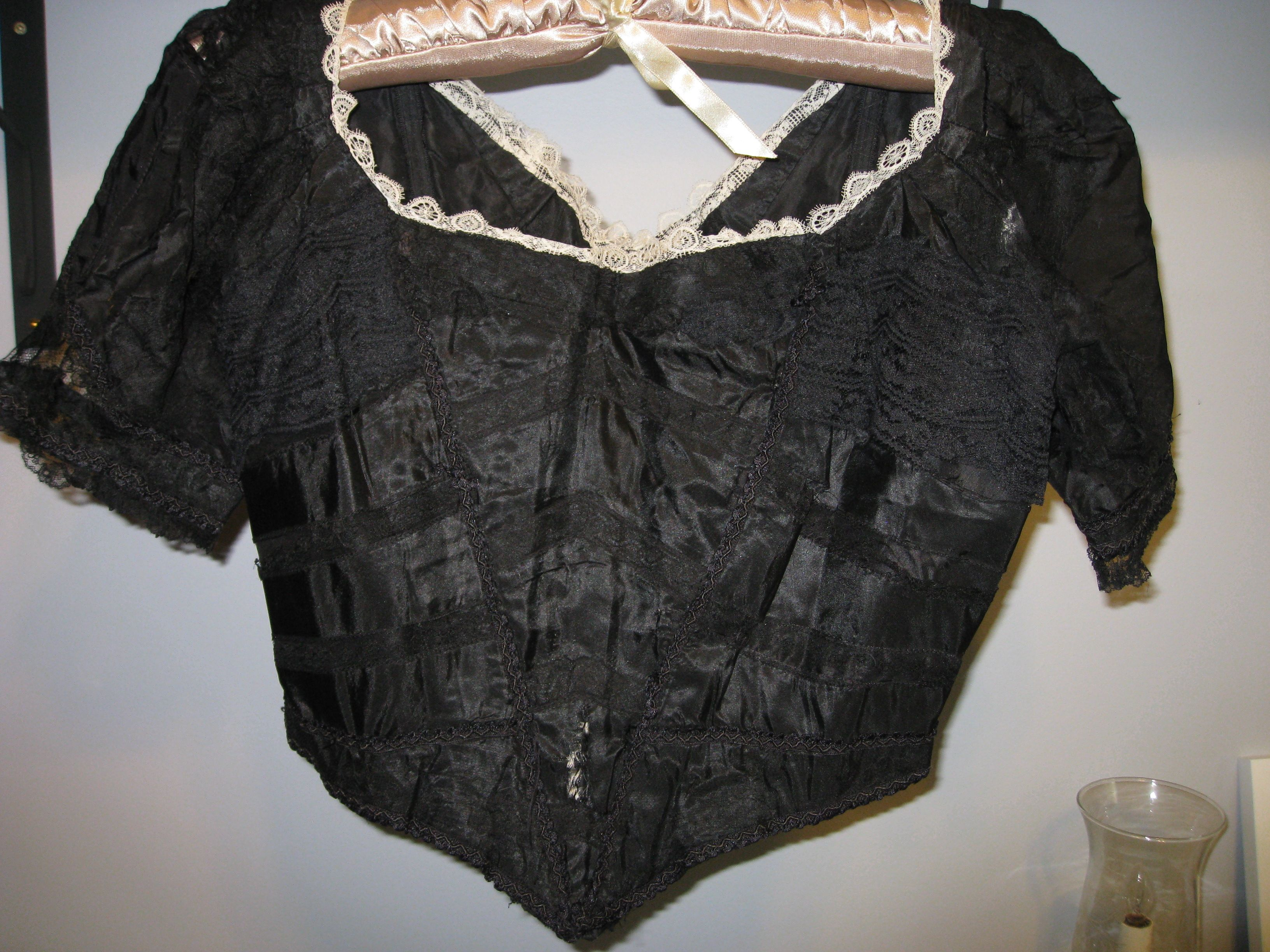 Silk and lace bodice (Edwardian?)  Boning, hooks and eyes, lace.  It's all here.