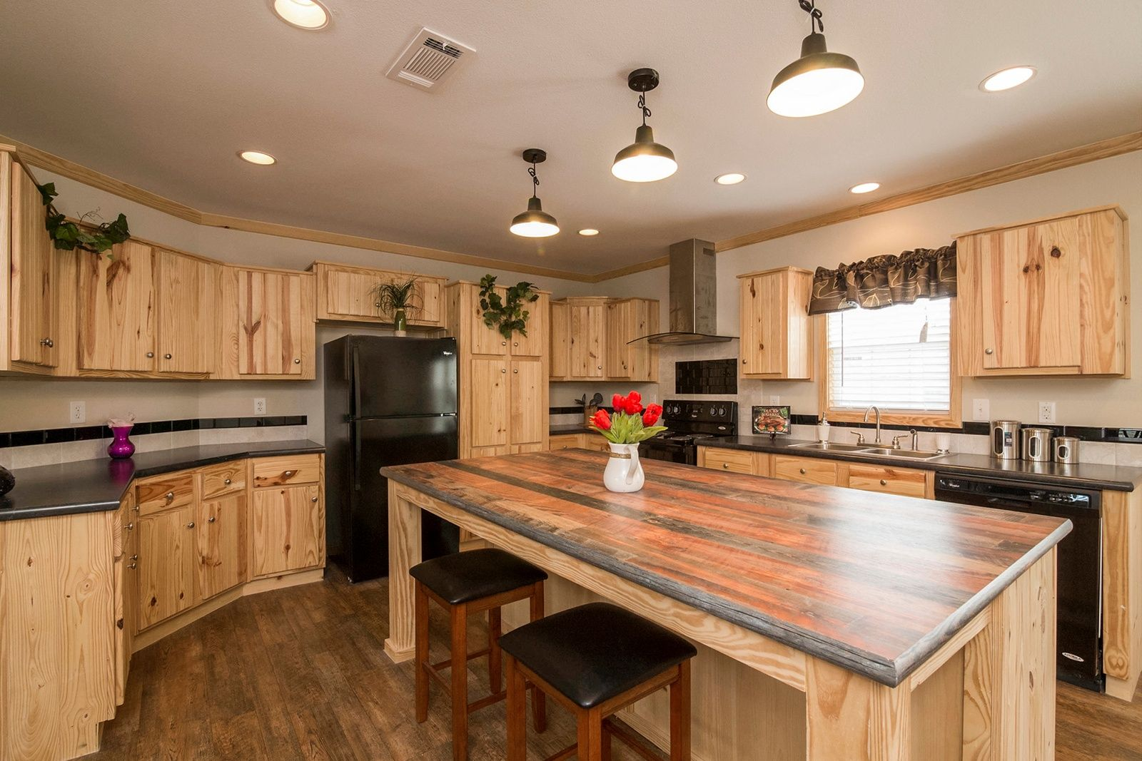 Rustic kitchen with knotty pine kitchen cabinets and wood ...