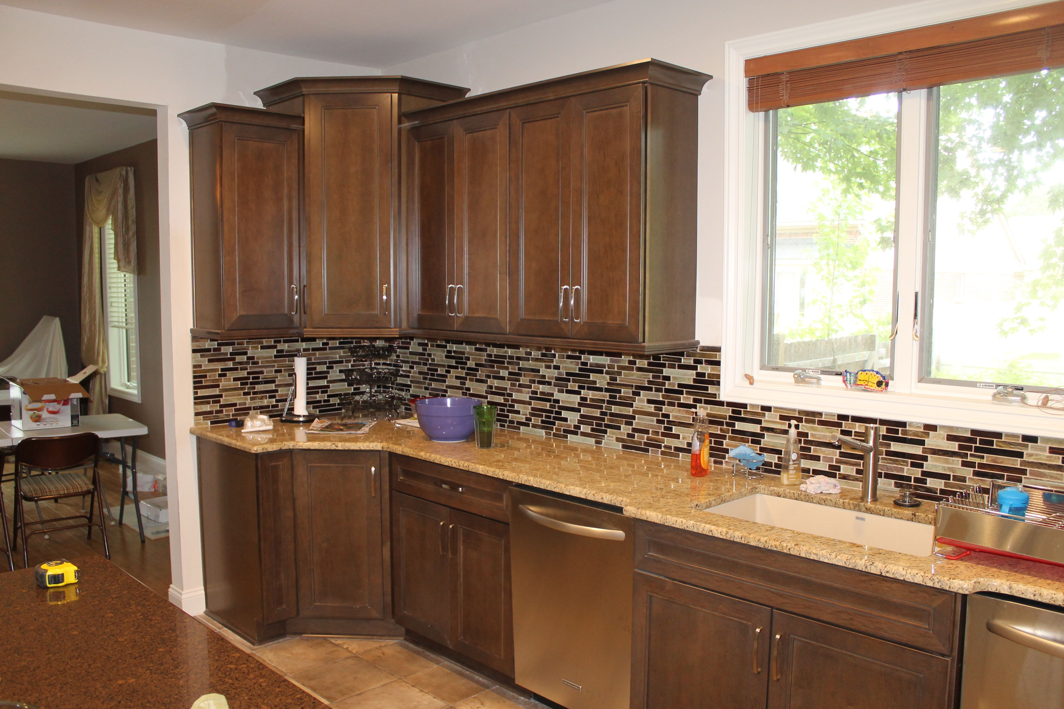 Medium Maple Cabinets with light Granite countertops and ... on Backsplash For Maple Cabinets And Black Granite  id=31955