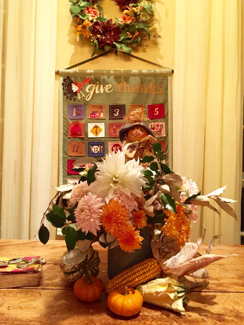 Thanksgiving family table - calendar from Pottery Barn kids and stowaway scarecrow