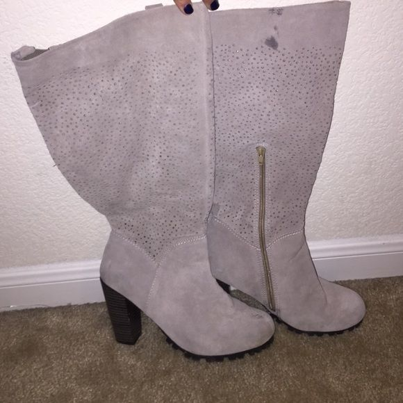 beige suede boots Very nice and comfortable! The inside is cushioned!!! The pictures seem to show as if they're white or gray but they are more of a nude or beige! I'm 5'4 and they go right below my knee. Other than a few stains throughout the boot they're in excellent condition, only worn a few times. Shoes
