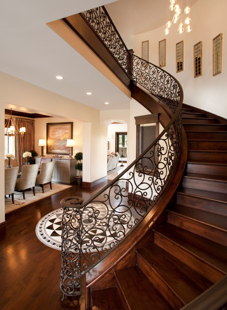 Wrought Iron Stair Railing Staircase Traditional With Cluster Pendant  Lights Curved Stairs Dark Wood