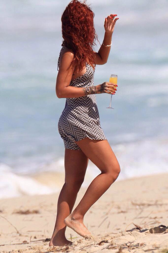 956c84f3d2d Rihanna looks super sexy in her mini dress while posing along the beach on  Sunday (April 19) in Honolulu