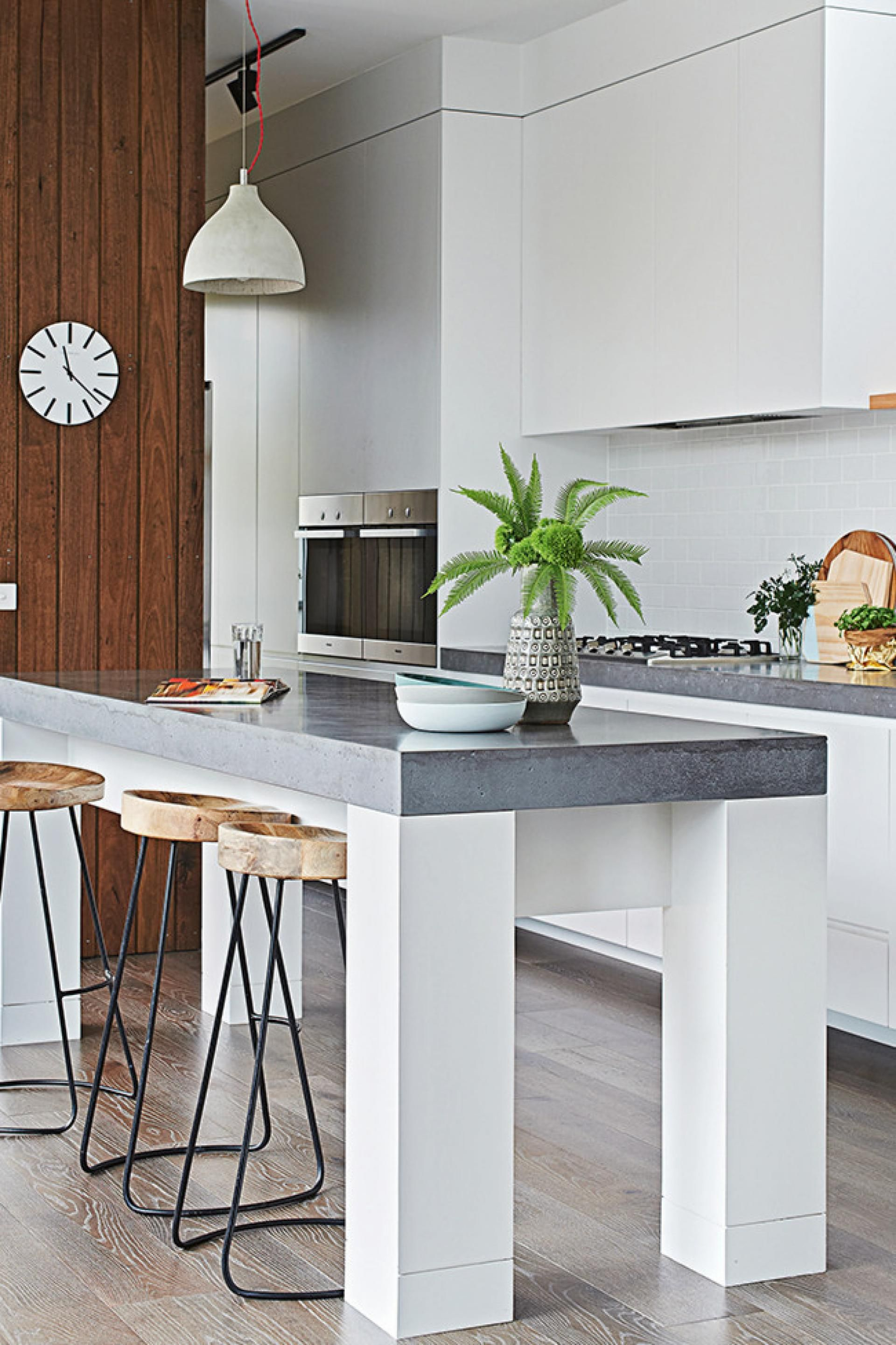 formed concrete bench top in this kitchen makes a timeless statement ...
