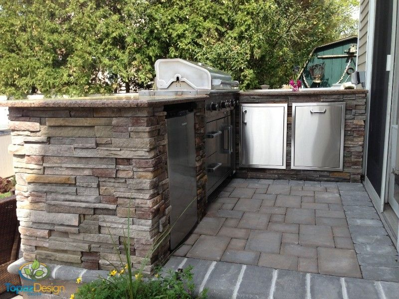 Need a drink or some yummy BBQ food? No problem! We designed and installed this stone veneer outdoor kitchen for all your cooking necessities!