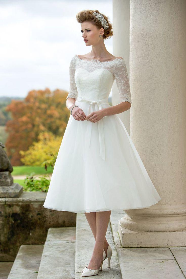 Tea length aline wedding dress features strapless sweetheart