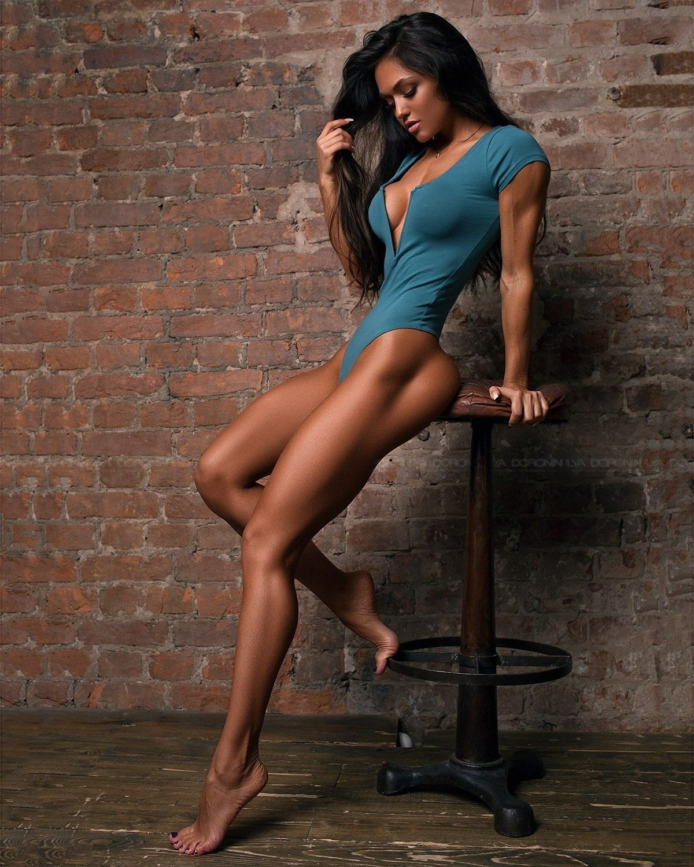 Beautiful woman long sexy legs dressed stock photo