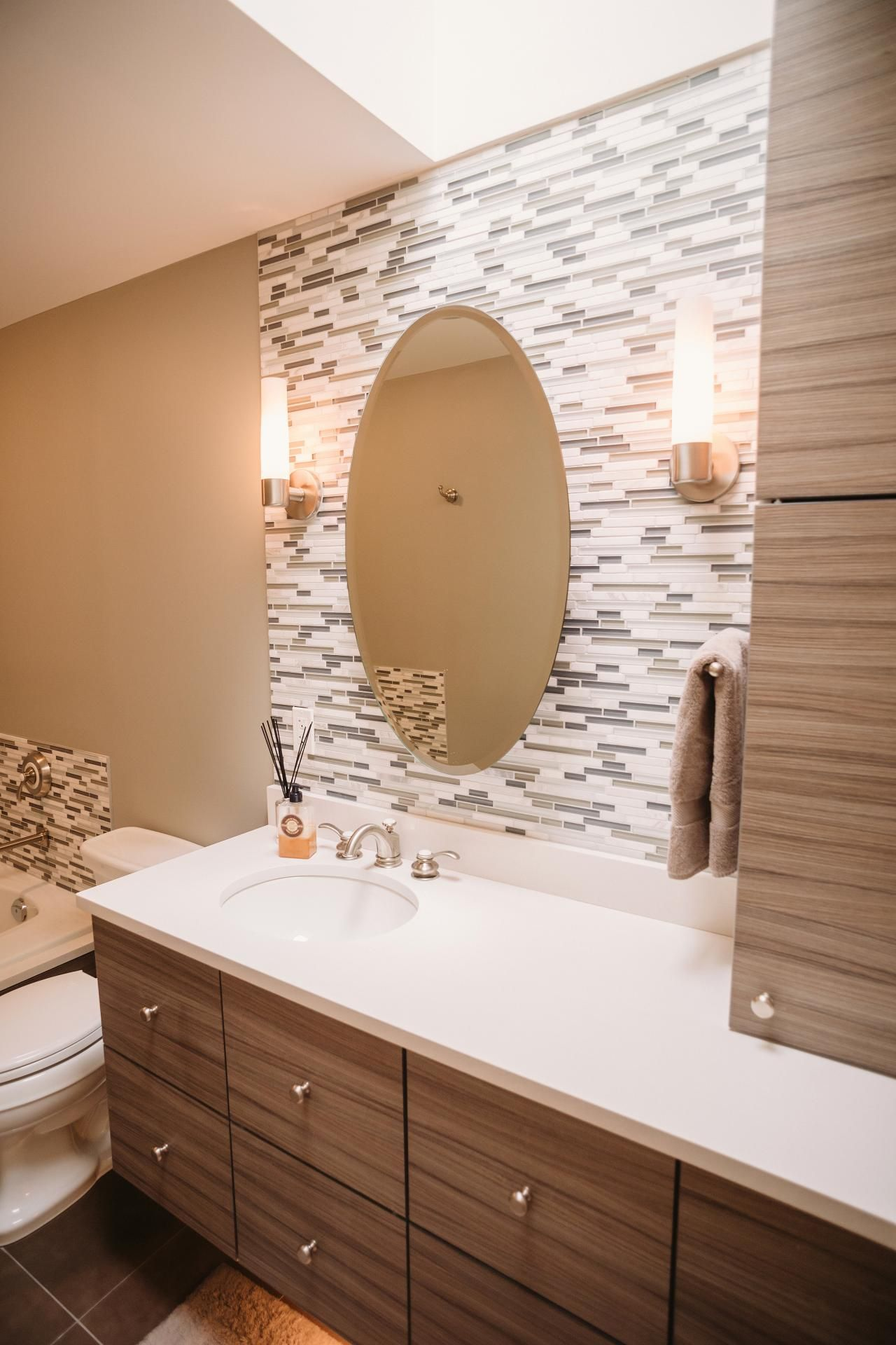 Bathroom Tile Accent Ideas Part - 27: The Attractive Accent Wall In This Contemporary Bathroom Features Thin Tiles  In White And Neutral Shades. Cylindrical Sconces Illuminate The Space, ...