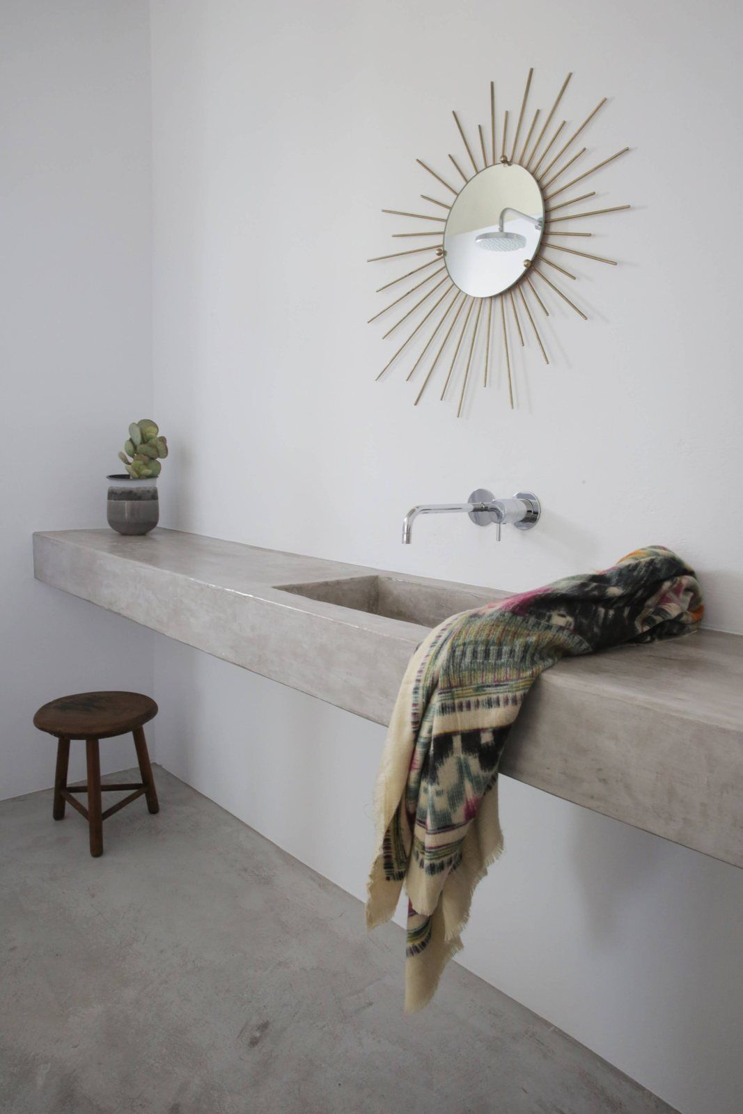Bathroom with concrete countertop and floor. Maison Kamari by React Architects. Photo by Damien De Medeiros.